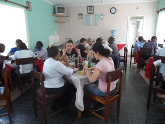 Caritas Foligno Delegation sharing a meal with the staff of Caritas Nyeri.