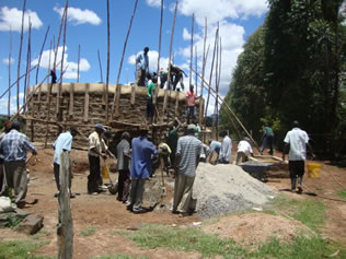 Community members participation in construction of a water tank.