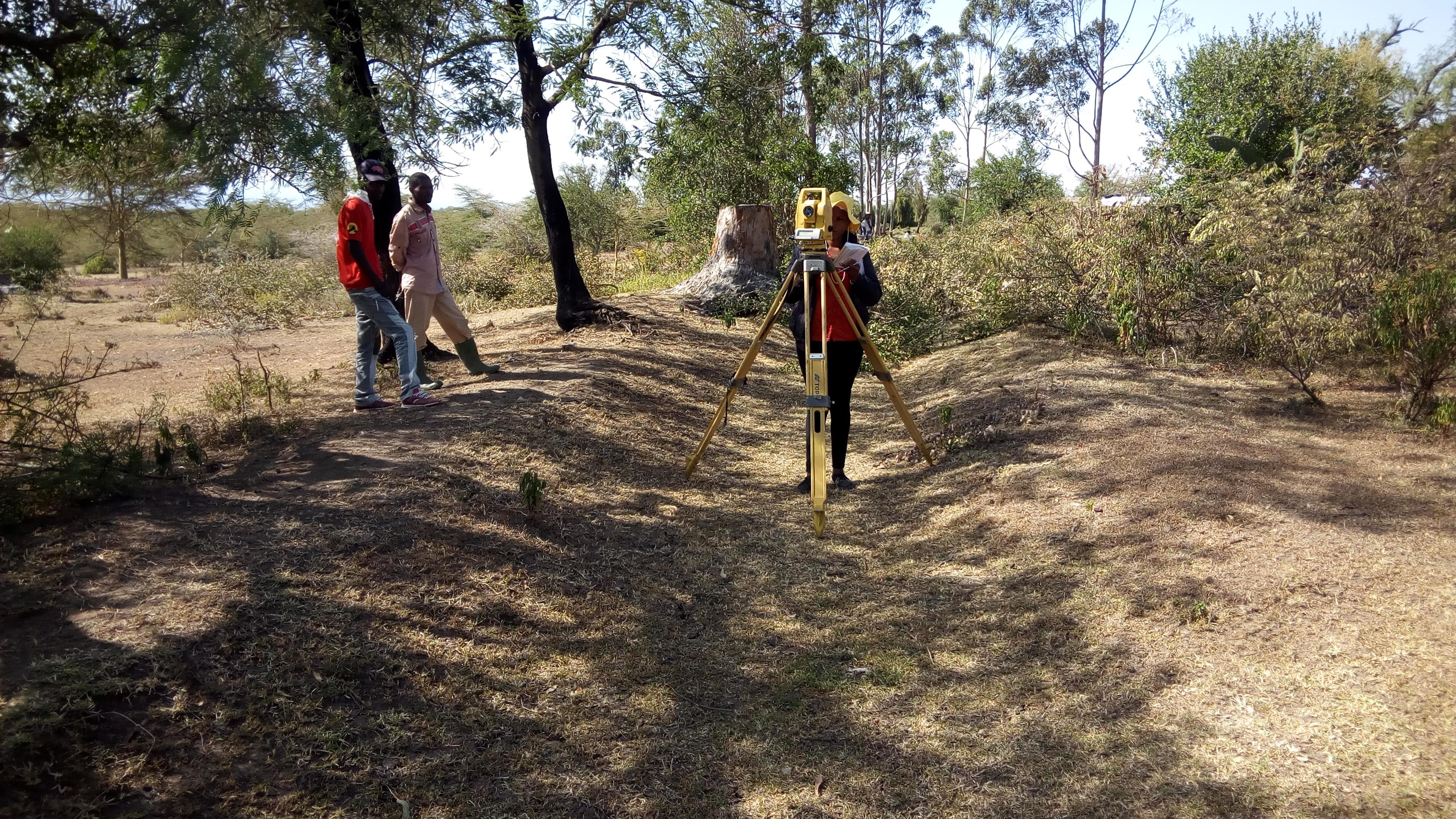 The surveyors at work carrying out engineering survey of the proposed water works